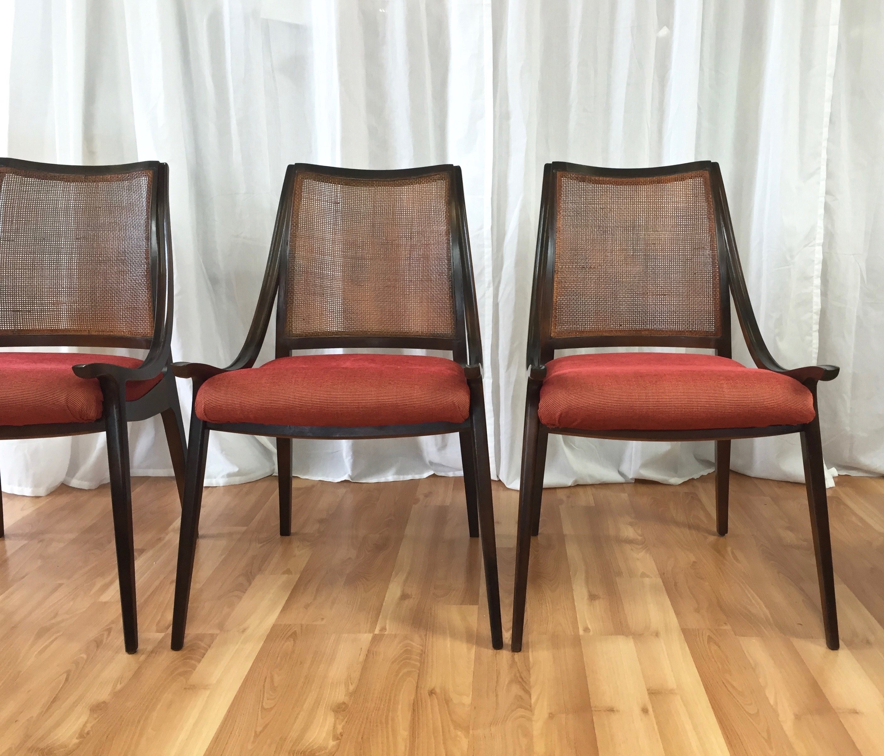 Four Cane Back Walnut Dining Chairs By Richard Thompson